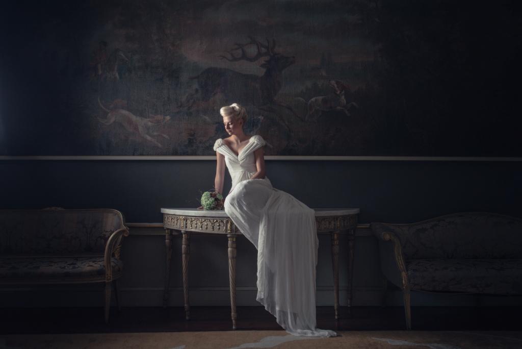 Pensive bride with wedding bouquet