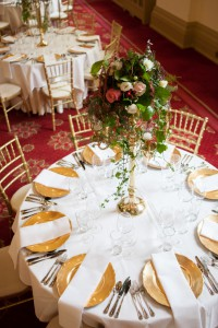 Corrigan Hall at Number 6 Kildare St. set for dinner with tall flower arrangement on gold candelabra