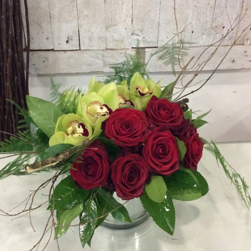 A Red Roses and Orchids Flower Arrangement