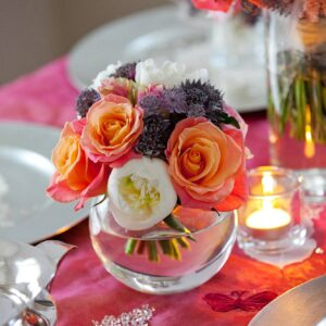 Mini table centre in goldfish bowl vase from our wedding cost guideion
