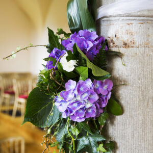 Flower decoration on a church pillar for a wedding