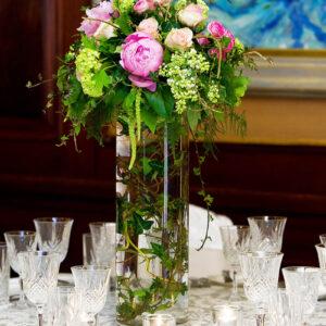 Tall wedding flower arrangement in glass vase