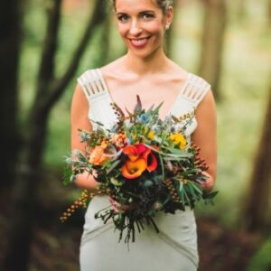 bride with her bouquet at an outdoor autumn wedding in Ireland