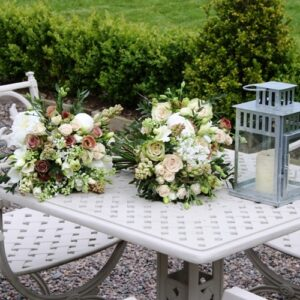 Brides and bridesmaids flower bouquets in antique pink creams and whites