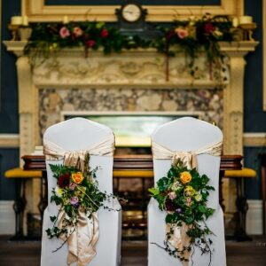 Groom and bride's chairback flower arrangements from wedding flower pictures gallery