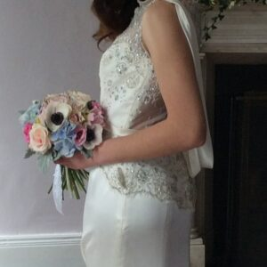 Ranunculus hydrangeas and roses in this brides bouquet from our wedding flower images