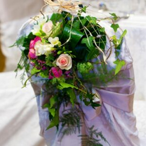 Flower arrangement on chairback from a Louth hotel in wedding flower pictures gallery