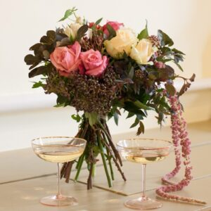 Pink and white roses with hanging amaranthus from the gallery of wedding flower pictures