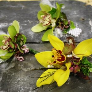 Gents button holes using orchids for wedding