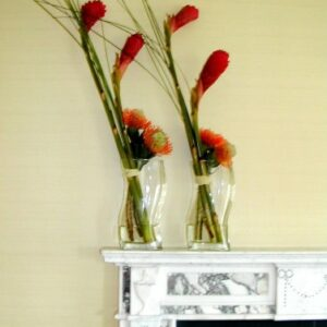 Twin flower arrangements on a mantle for a corporate client in Dublin for s