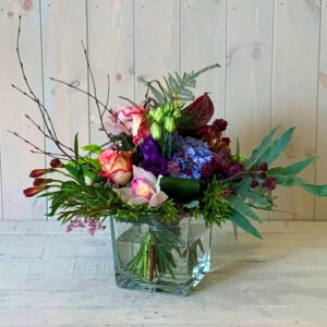 Country garden flower arrangement in glass vase