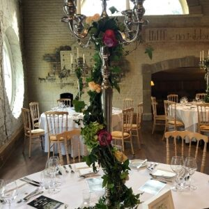 Flowers used to dress an ornate candelabra at The Cliff at Lyons Estate