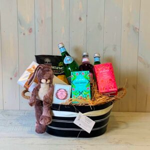 A gift hamper with treats for a new mum and her new baby