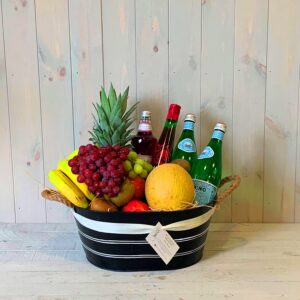 Gift hamper with fruit, mineral water and cordials i
