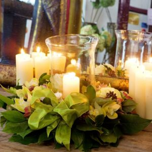 Flowers and hurricane lamp for wedding table centre