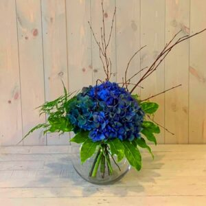 Hydrangea flowers in a clear glass goldfish bowl vase delivered same day in Dublin city and county.n