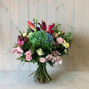Beautiful Lily Rose and Orchid Flower Bouquet with seasonal flowers and foliage. Available for delivery in Dublin and throughout Ireland