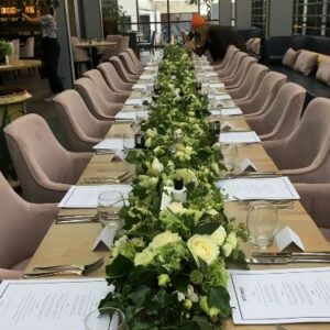long flower table centre for corporate event - image from flowers for events gallery