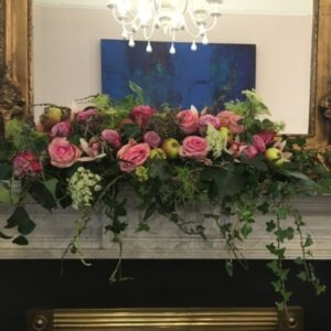 Mantle flower arrangement of pink roses for a wedding