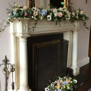 Mantle flower arrangements for a wedding set in a private home
