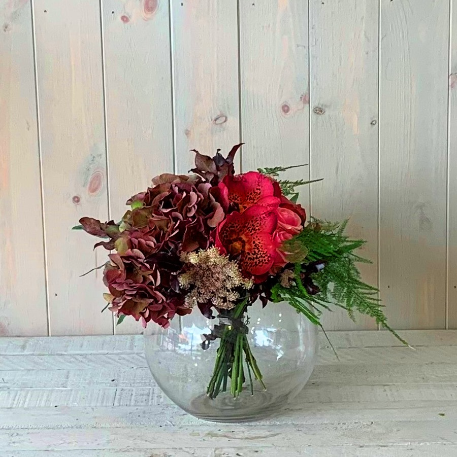 Orchid and Hydrangea Flowers in Goldfish Bowl Vase