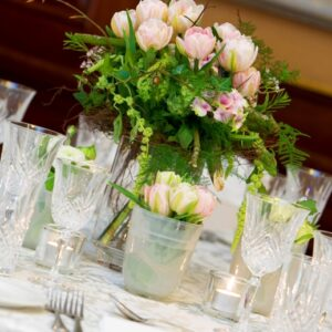 Table centre of pink flowers in a Wicklow hotel from the gallery of wedding flowers images