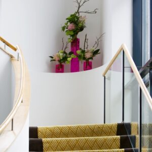 Hotel stairs flower arrangement - image from flowers for events gallery