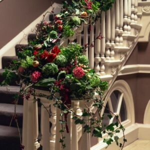 sweeping staircase decorated with roses and ivy from wedding flowers pictures
