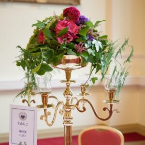 Floral table centre on candelabra at corporate dinner - image from flowers for events gallery