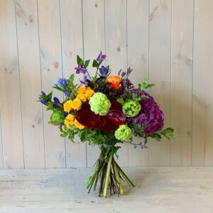 Vivid Yellow and Purple Hand-Tied Flower Bouquet. Available for delivery in Dublin and Ireland by award winning florists. i