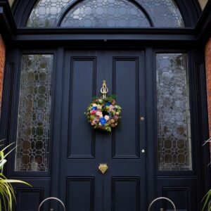 Image of flowers door wreath for a wedding from wedding fflower costs