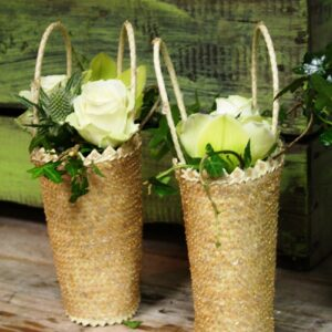 Images of wedding flowers of a flower girls basket