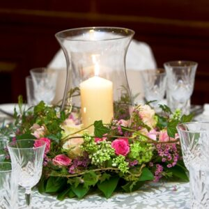 From our images of wedding flowers a colourful table centre with huricane lamp and candle