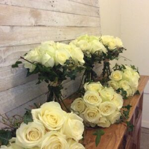 Wedding flowers of white roses and trailing ivy