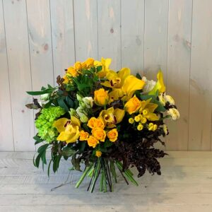 Flower bouquet of yellow roses and orchids