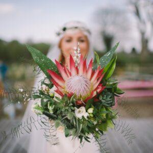 Protea wedding bouquet held by a bride