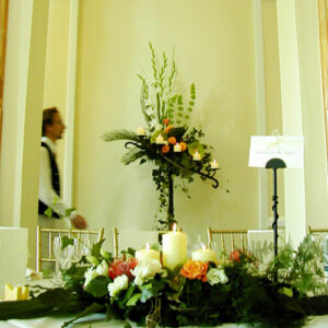 Pedestal flower arrangement in autumn colours designed for a wedding in Wicklow