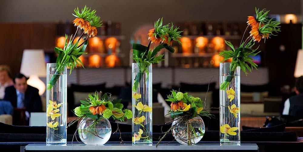 Flower arrangements set in bar of a Dublin hotel lobby