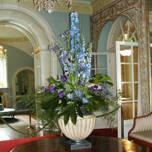 Floral table centre for Farmleigh House with blue flowers in urn