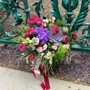 Colourful bridal bouquet in blues pinks and purples
