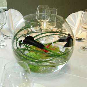 table arrangement of flowers in a fishbowl at a Dublin corporate event