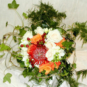 Weddings flower image of brides bouquet using peach and white roses with nutan and berry