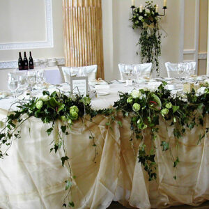 Top table setting of white wedding flowers
