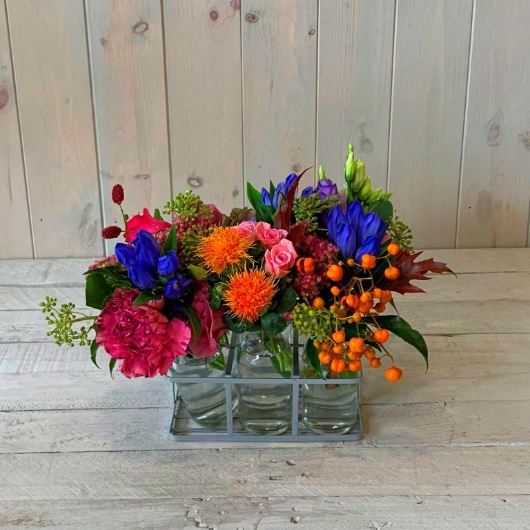 Pretty little bottles filled with seasonal flowers for delivery in Dublin