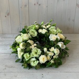 Funeral wreath in creams greens and whites. Funeral and Sympathy flowers for delivery in Dublin