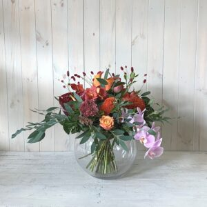 Beautiful autumn flowers in goldfish bowl vase for delivery in Dublin city and county
