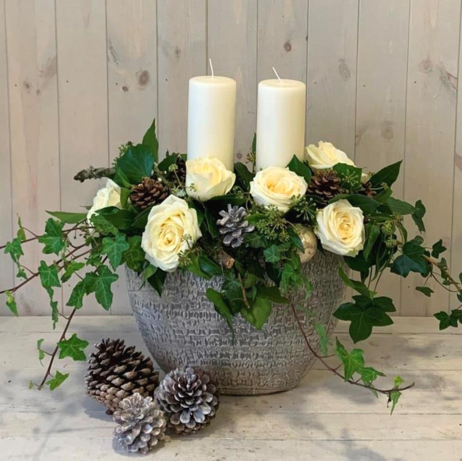 Christmas candle flower arrangement in whites for delivery in Dublin