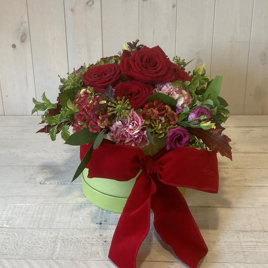Christmas Hatbox Flowers in Reds