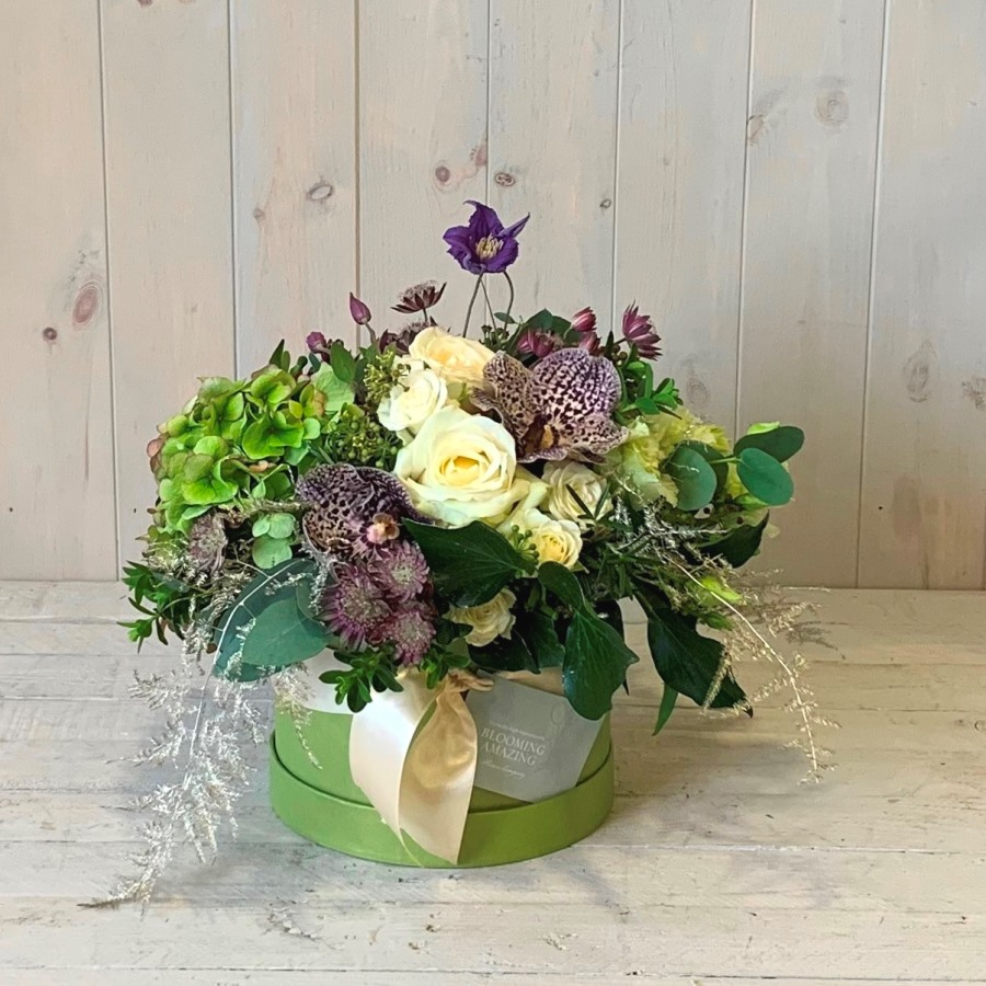 Winter flowers arranged in a hatbox