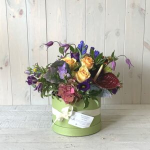 Colourful and vibrant spring flowers in a hatbox. Spring gift delivery in Dublin